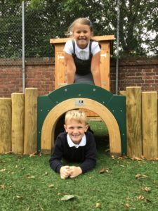 School children using play space